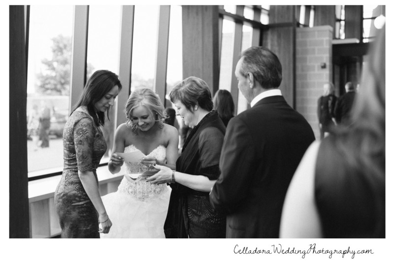 bride-looking-at-photobooth-prints-800x534 Nashville Wedding Photography   WO Smith Music School