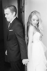 bride-and-groom-holding-hands-around-door-200x300 bride-and-groom-holding-hands-around-door