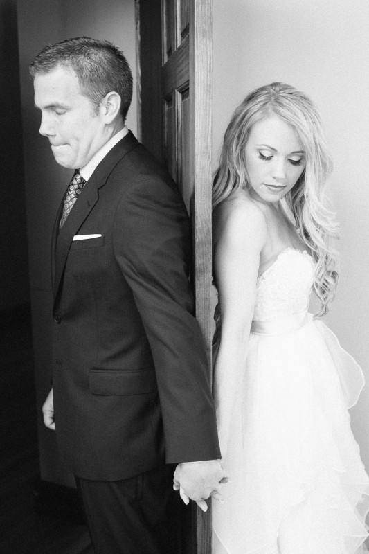 bride-and-groom-holding-hands-around-door-533x800 One Cannery Ballroom Nashville 4th of July Wedding   Brian and Jenna