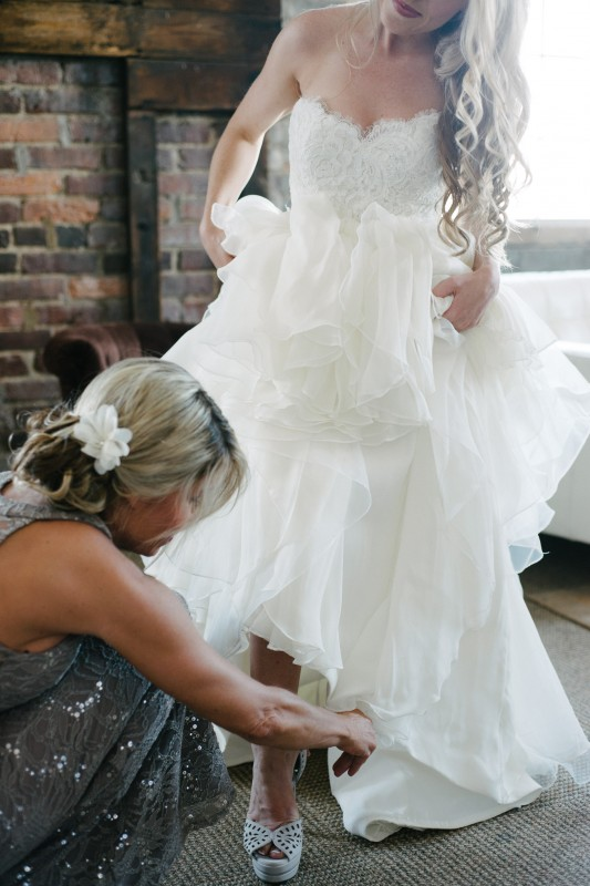 bride-getting-into-shoes-533x800 One Cannery Ballroom Nashville 4th of July Wedding   Brian and Jenna
