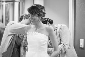 bridesmaids-helping-bride-into-dress-300x200 bridesmaids-helping-bride-into-dress