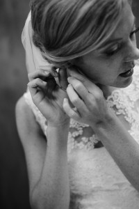 bride-putting-on-earrings-200x300 bride-putting-on-earrings