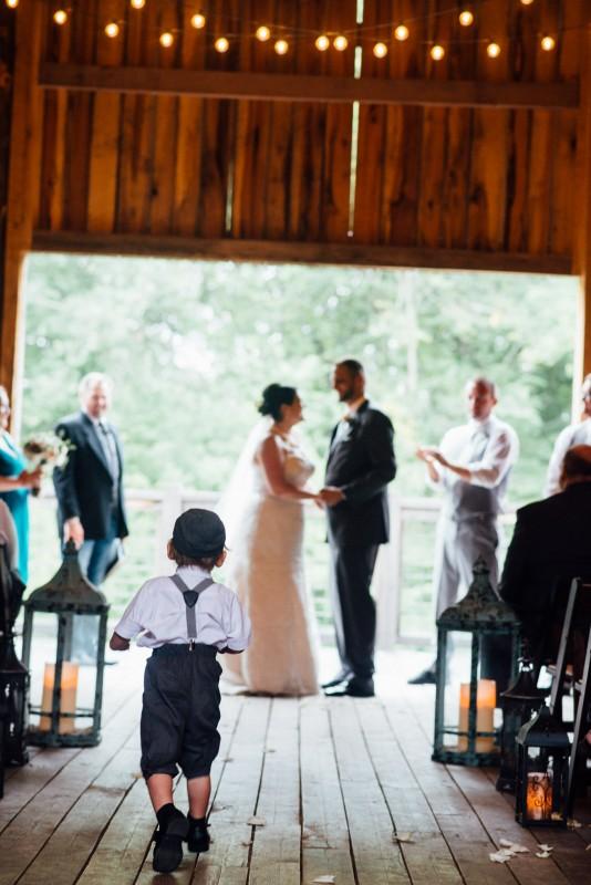 son-running-towards-parents-wedding-534x800 Outdoor Barn Wedding | Murfreesoro, TN | Paul and Amanda