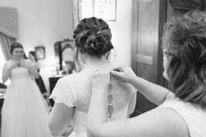 bride-getting-into-dress-300x200 bride-getting-into-dress