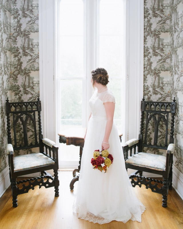 bride-looking-out-window1-640x800 Two Rivers Mansion Fall Wedding | Kristen and Chris