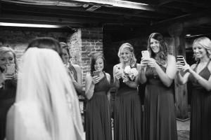 bridesmaids-taking-iphone-photos-300x200 bridesmaids-taking-iphone-photos