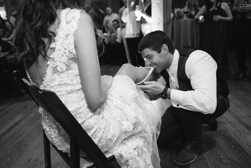 groom-taking-garter-with-teeth-800x534 Kristen and Nick Wedding at aVenue | Nashville, TN