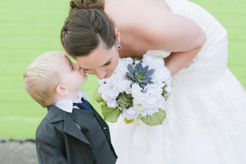 ring-bearer-kissing-bride-800x534 Elisa + Jerrad Wedding | Balinese Ballroom | Memphis, TN
