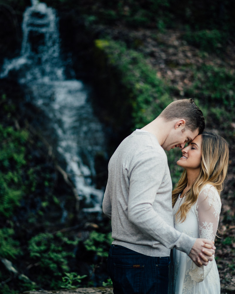 forehead-to-forehead-pose Rock Island, Tennessee | Waterfall Engagement