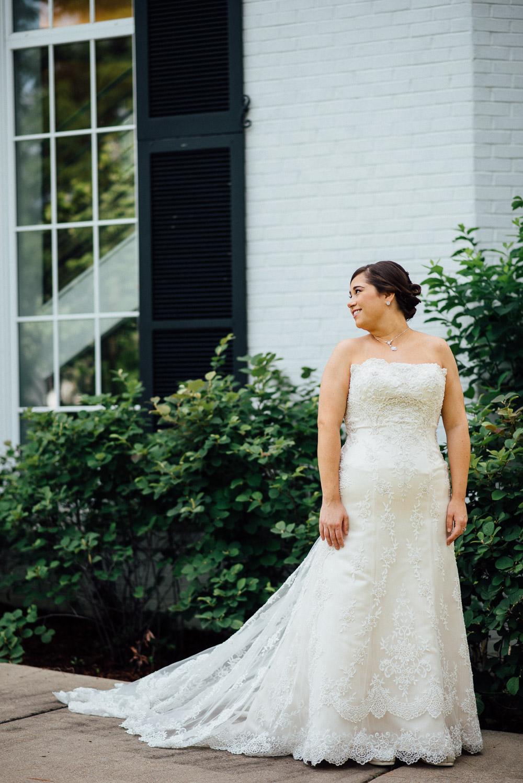 bride-looking-over-shoulder Amy + Tara | Travellers Rest Plantation Wedding