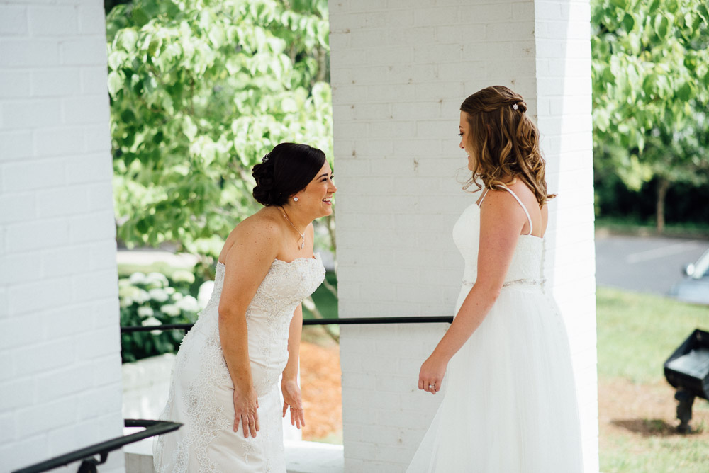 two-brides-first-look Amy + Tara | Travellers Rest Plantation Wedding