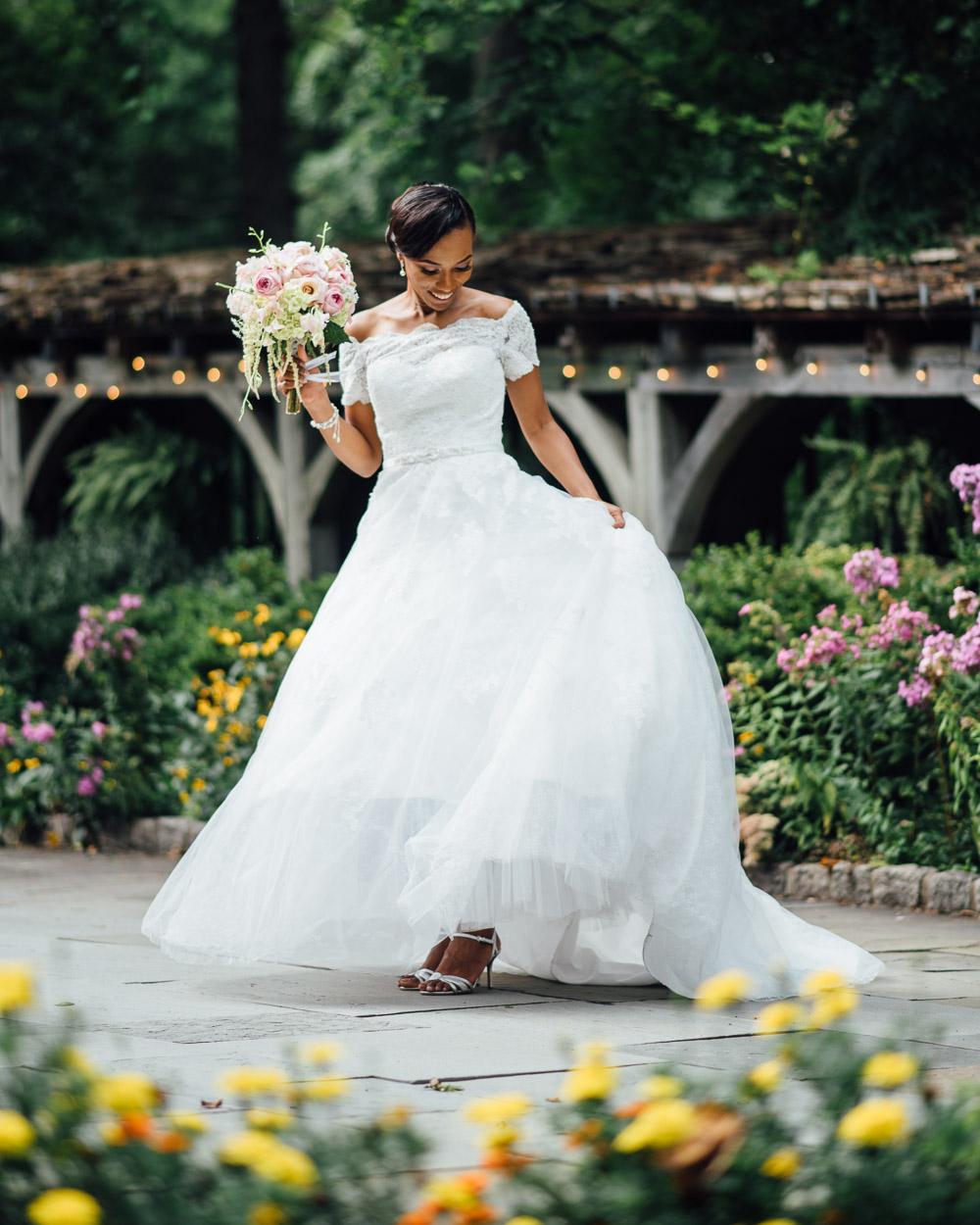 bride-in-garden Cloisters Castle Wedding | Towson Maryland
