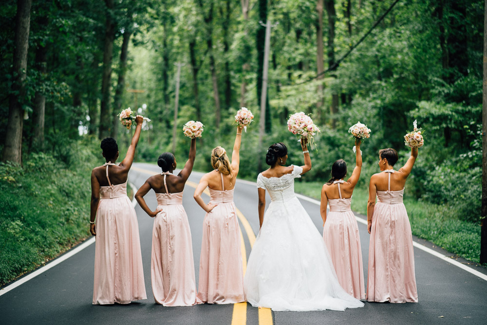 bridesmaids-flowers-in-air Cloisters Castle Wedding | Towson Maryland