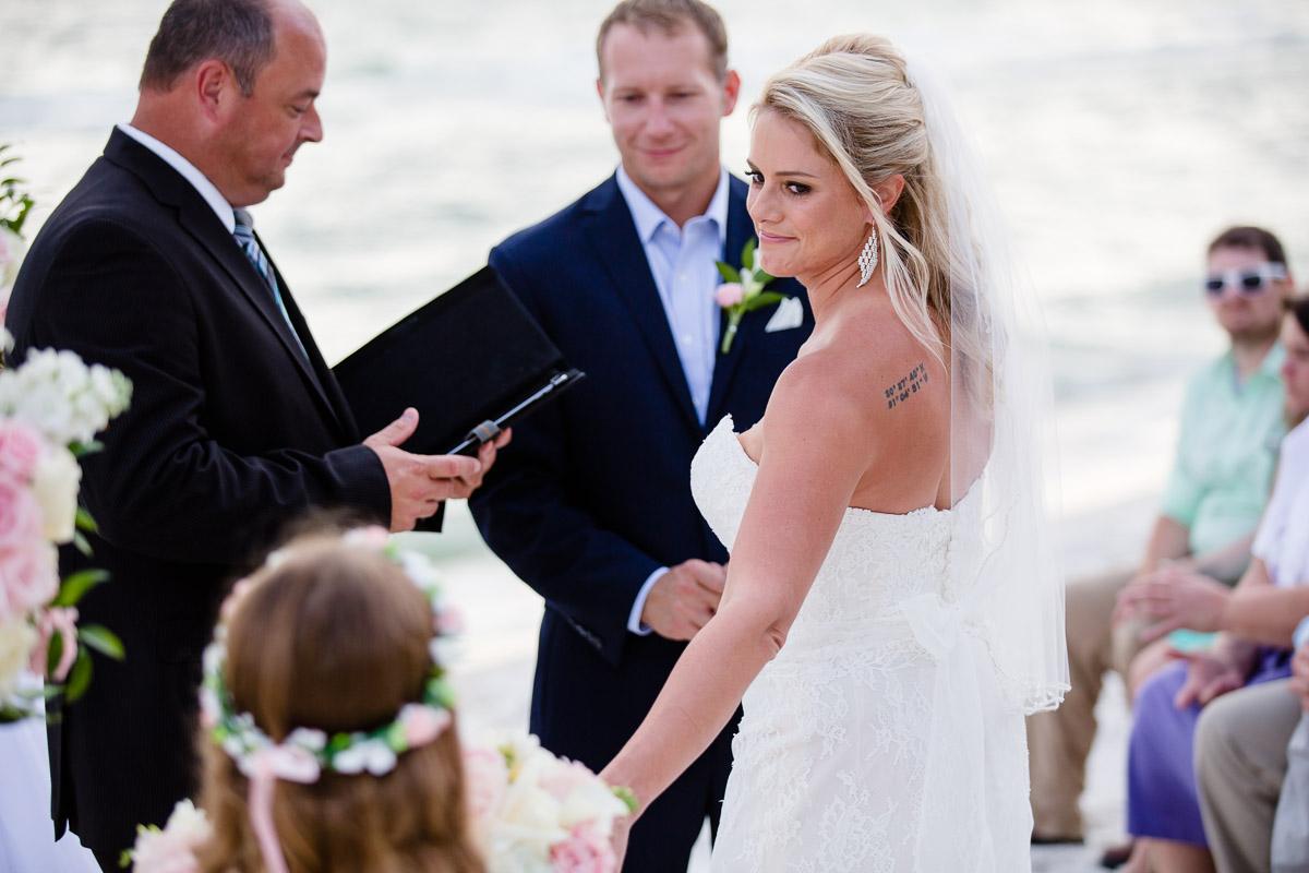 bride-handing-flowers Destin Beach House | Destination Wedding | Kasey and Rocky