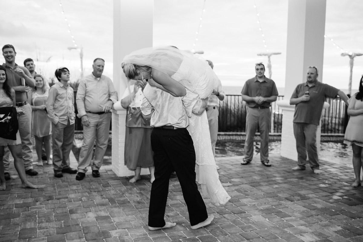 groom-picking-up-bride Destin Beach House | Destination Wedding | Kasey and Rocky