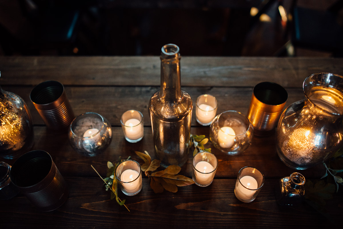 candles-and-bottles-centerpieces Becky and Alex | Green Door Gourmet - Fall Nashville Wedding