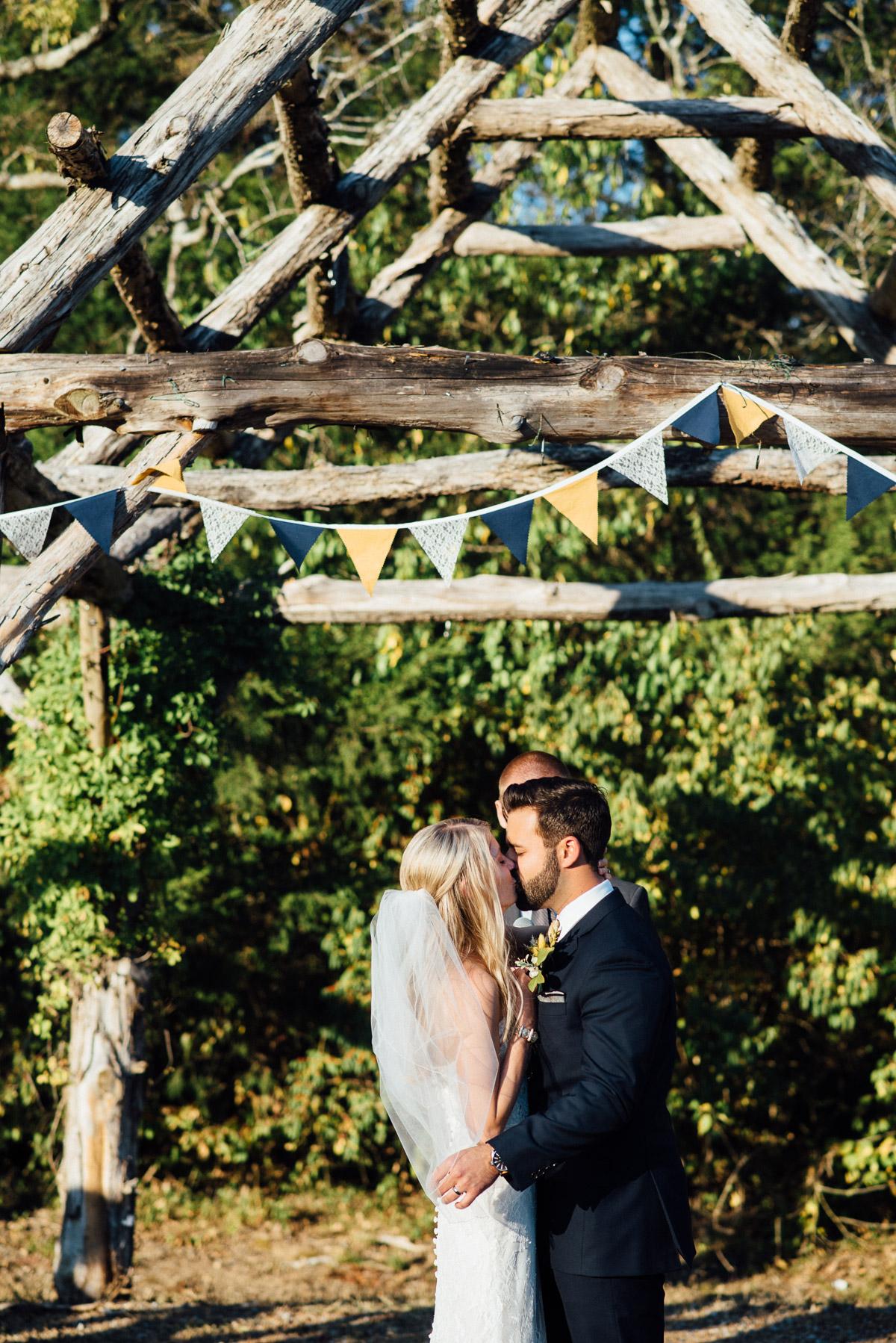 first-kiss Becky and Alex   Green Door Gourmet - Fall Nashville Wedding