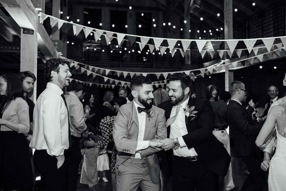 groom-dancing-with-friend Becky and Alex   Green Door Gourmet - Fall Nashville Wedding