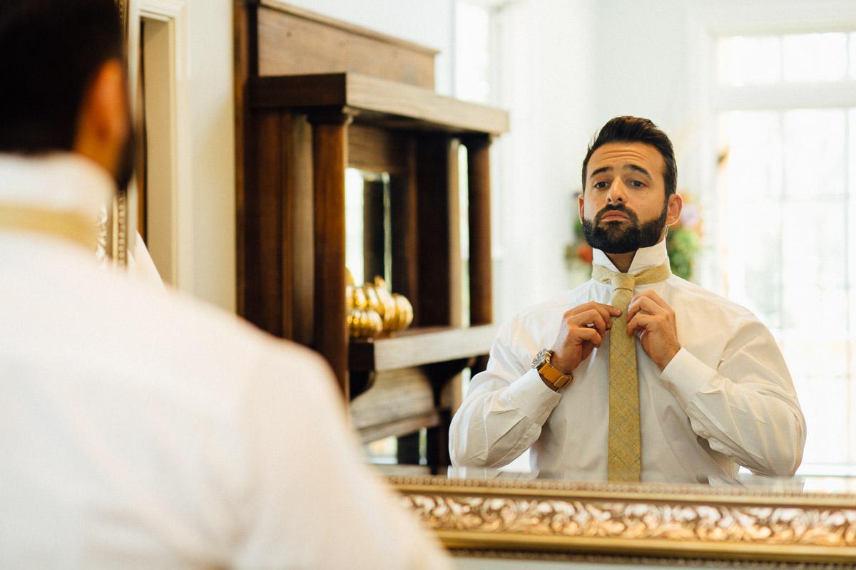 groom-tying-tie Becky and Alex   Green Door Gourmet - Fall Nashville Wedding
