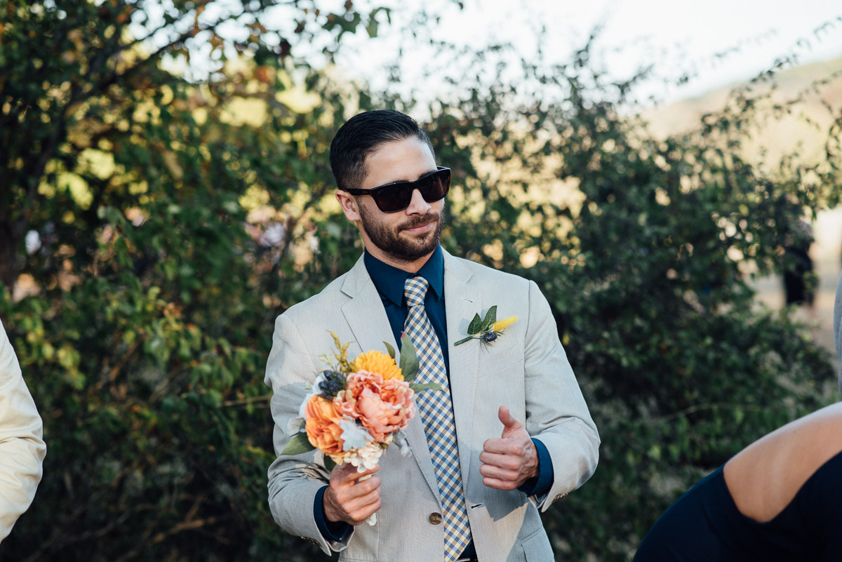 guy-holding-bouquet Becky and Alex | Green Door Gourmet - Fall Nashville Wedding