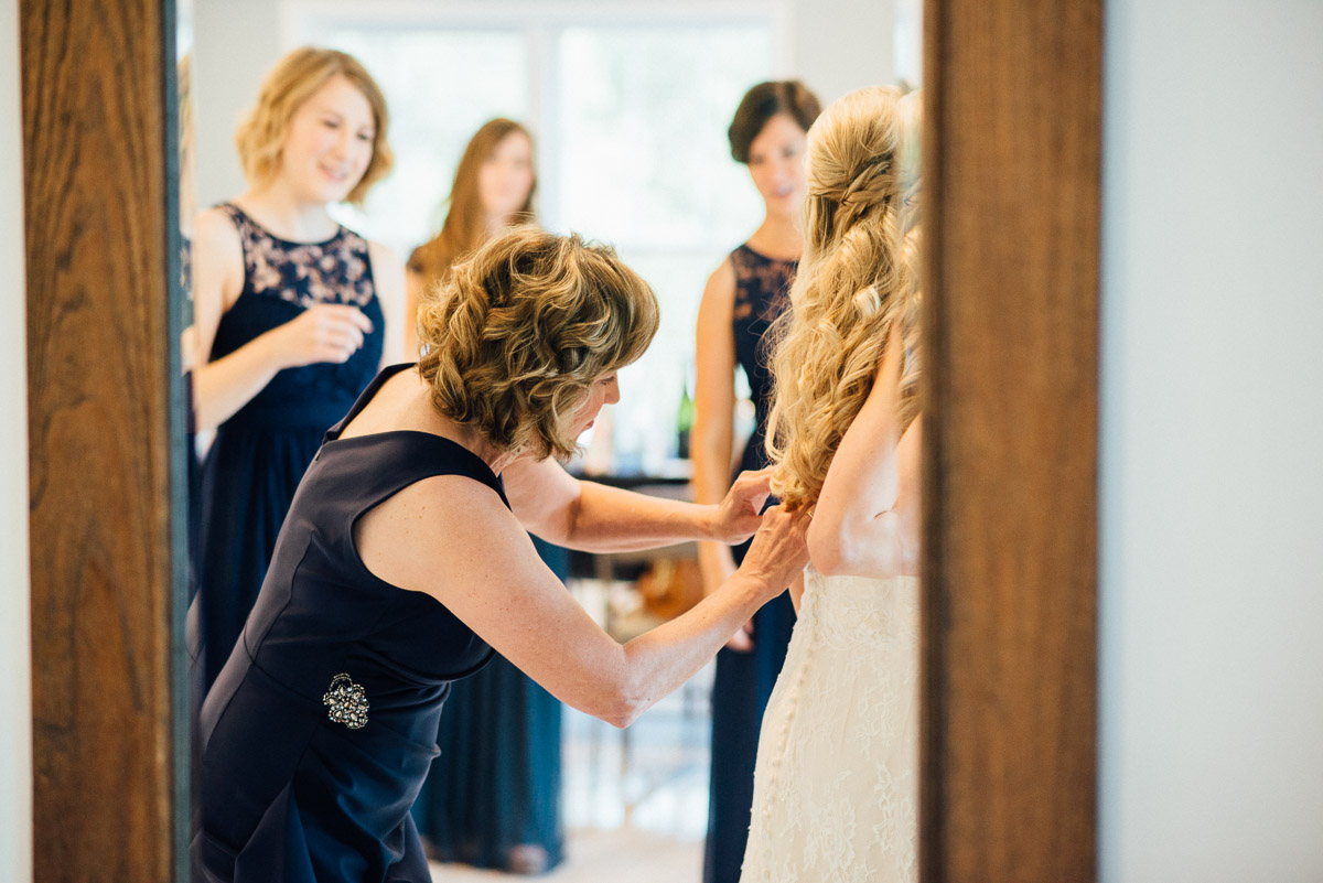 mother-helping-bride-into-dress Becky and Alex | Green Door Gourmet - Fall Nashville Wedding