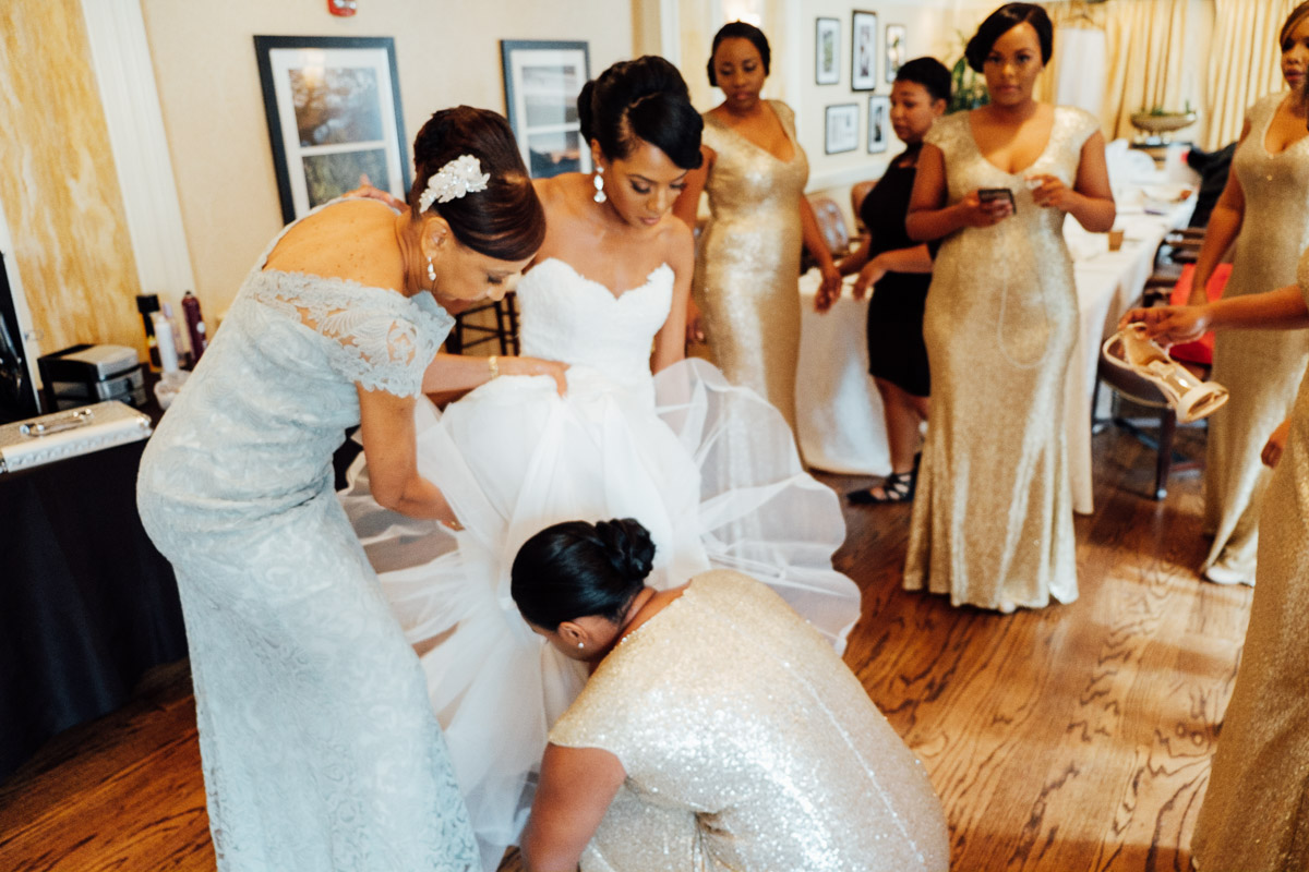bride-getting-in-dress Hermitage Hotel Wedding | Barbara and Darrius