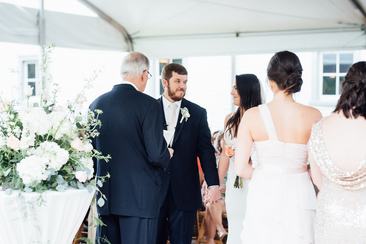 bride-groom-exchanging-glances-during-ceremony Belle Meade Plantation Wedding | Kendall and Andrew