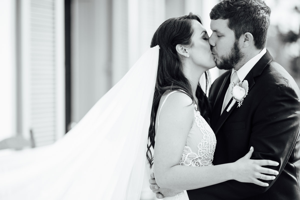 bride-groom-kiss-black-and-white Belle Meade Plantation Wedding | Kendall and Andrew