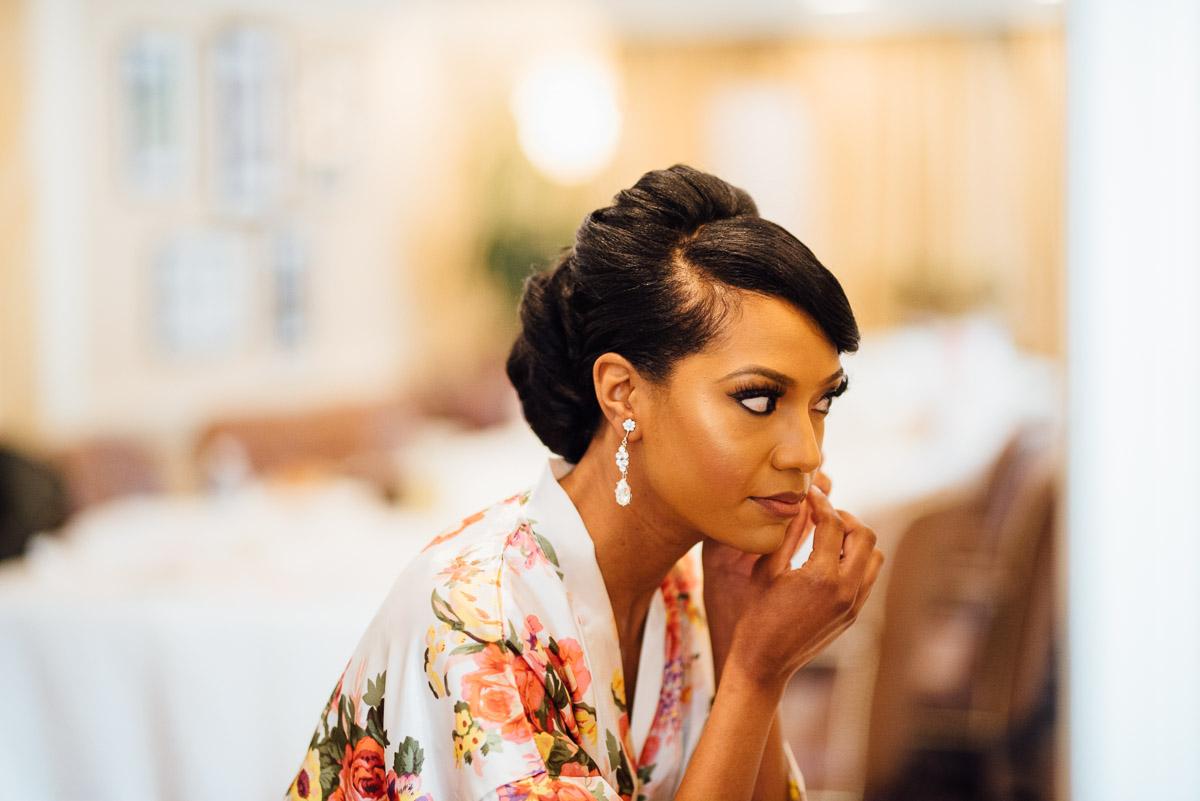 bride-putting-earrings-on Hermitage Hotel Wedding | Barbara and Darrius
