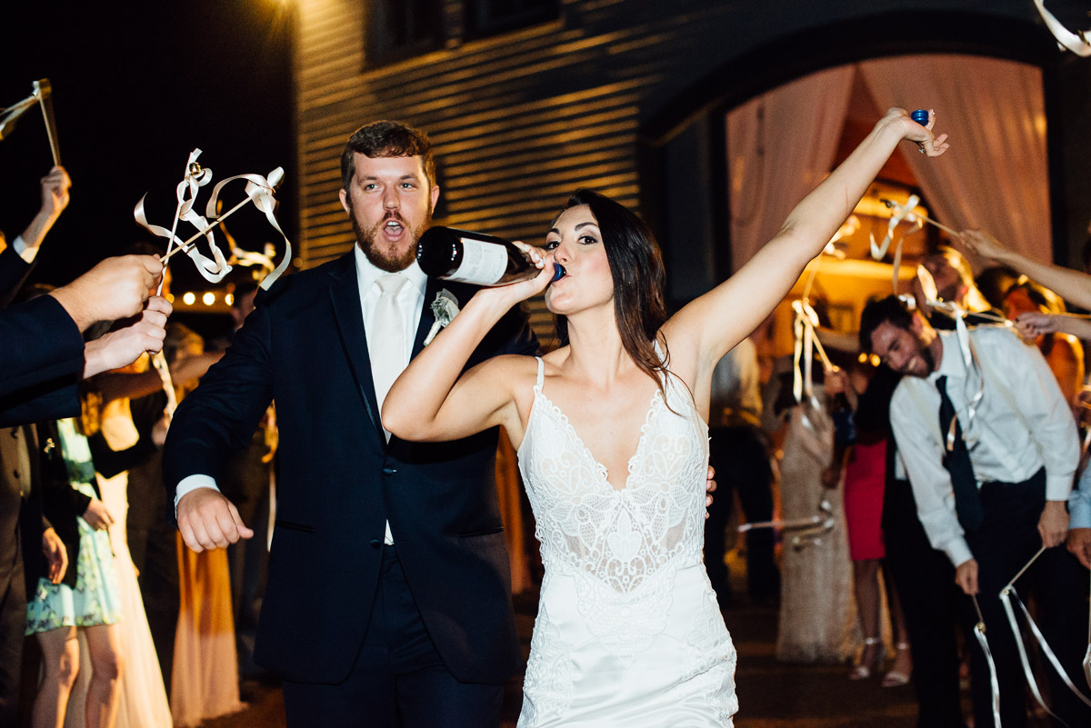drinking-wine-during-wedding-exit Belle Meade Plantation Wedding | Kendall and Andrew