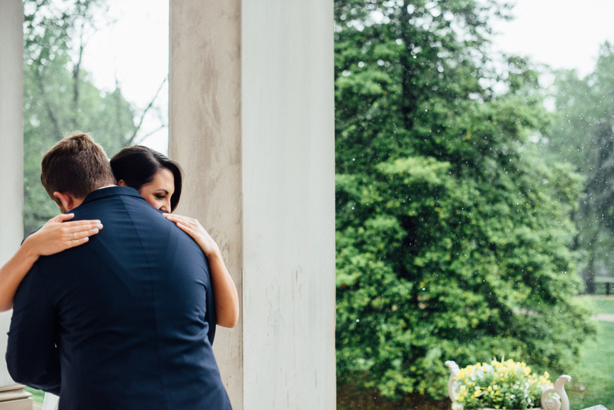first-look-in-rain Belle Meade Plantation Wedding | Kendall and Andrew