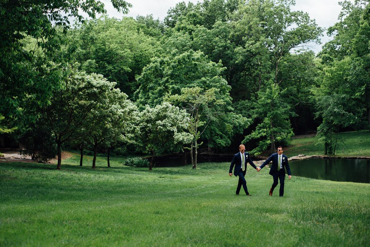 holding-hands Cheekwood Garden Wedding | Tom and Guy
