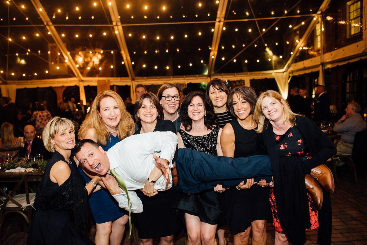 ladies-lifting-groom Cheekwood Garden Wedding | Tom and Guy