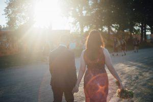 bonnaroo-wedding-holding-hands-300x200 bonnaroo-wedding-holding-hands