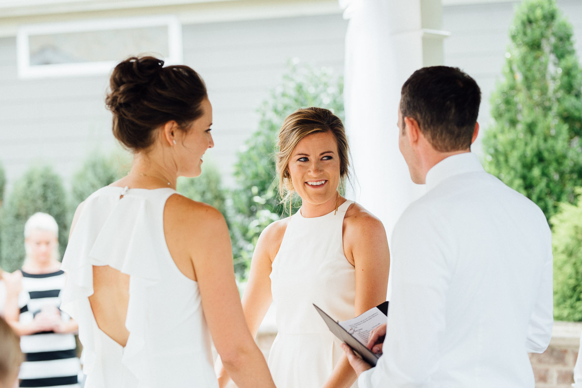 brides-holding-hands Becky and Kelly | Intimate Backyard Wedding