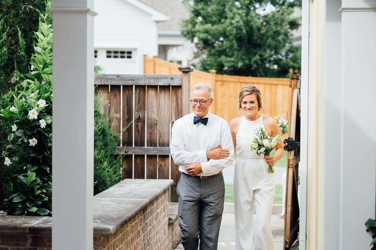 father-walking-daughter Becky and Kelly | Intimate Backyard Wedding