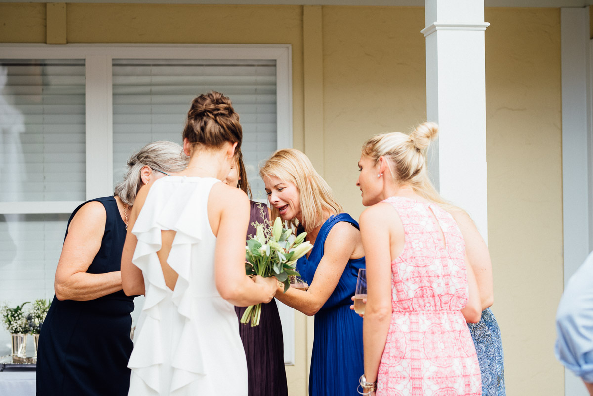 showing-off-ring Becky and Kelly | Intimate Backyard Wedding