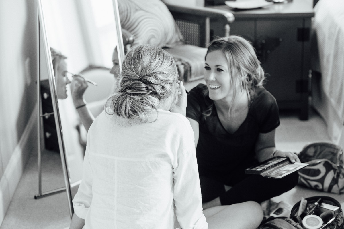 sister-helping-bride-with-makeup Becky and Kelly | Intimate Backyard Wedding