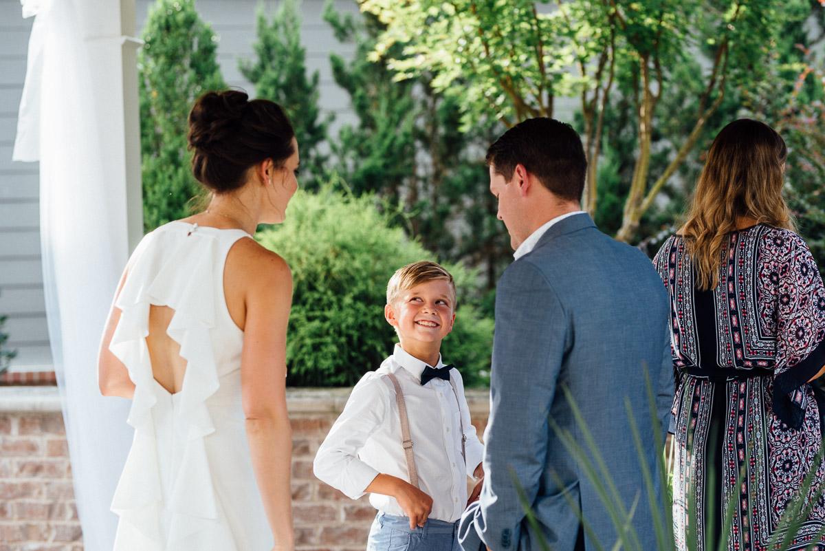smiling-kid-wedding Becky and Kelly | Intimate Backyard Wedding