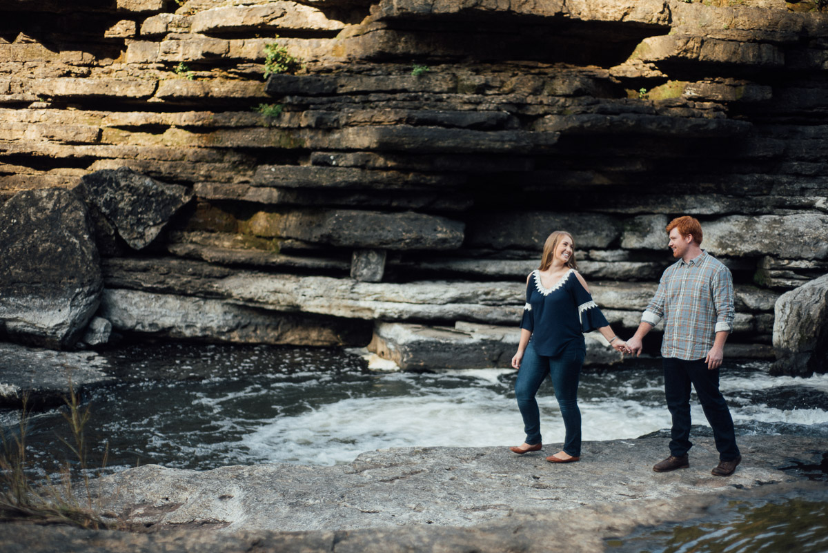 couple-walking Rock Island State Park Engagement Photos