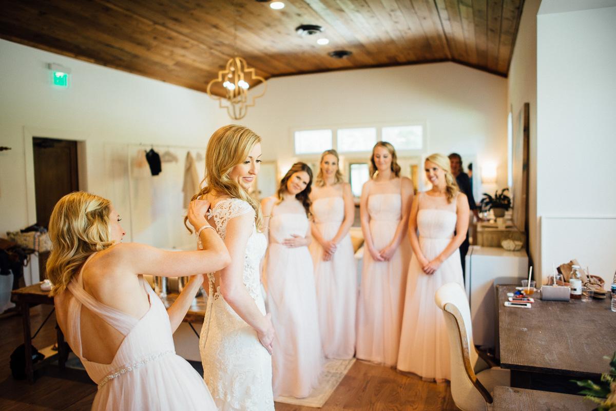 bridesmaids-watching-bride-get-dressed Graystone Quarry Wedding   Brad and Nicole