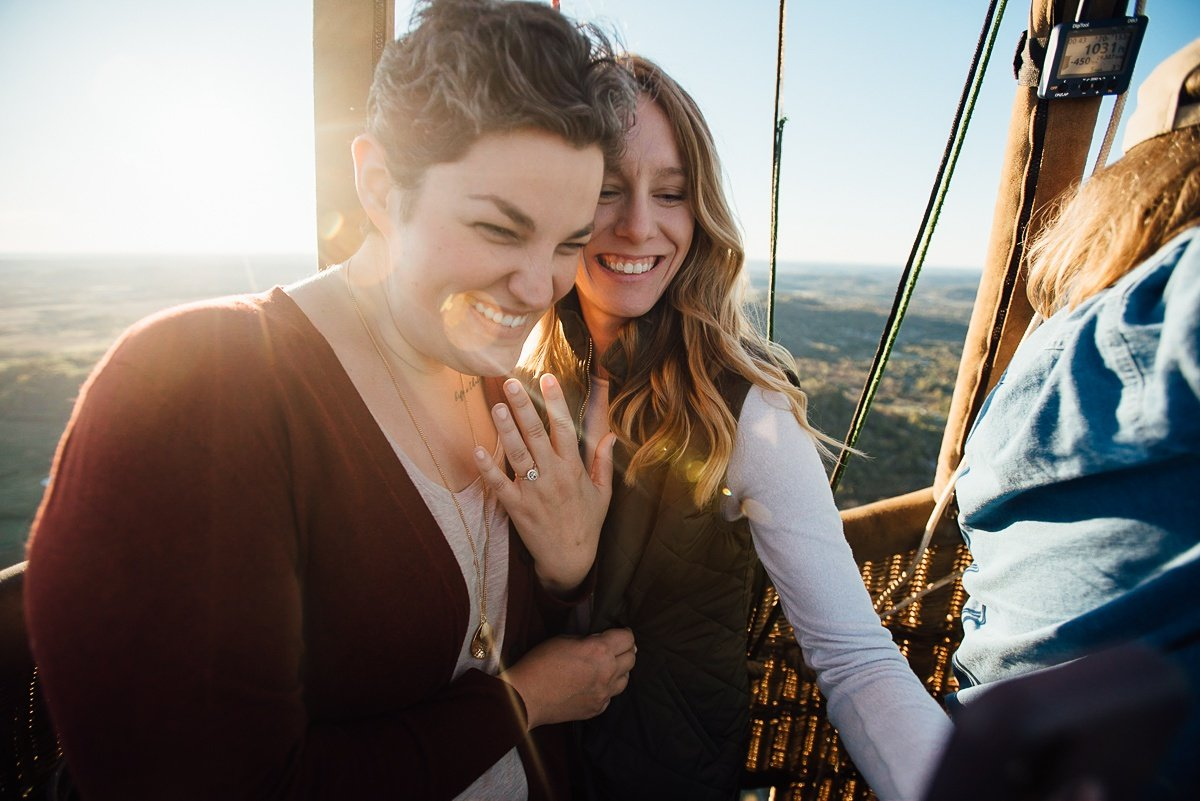 showing-off-engagement-ring Hot Air Balloon Proposal