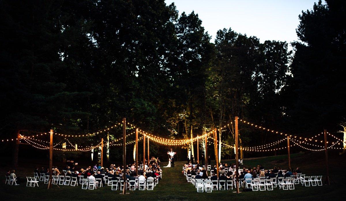 wedding-ceremony-under-string-lights Old Glory Distilling Co Wedding   Clarksville, TN   Matt + Shannon