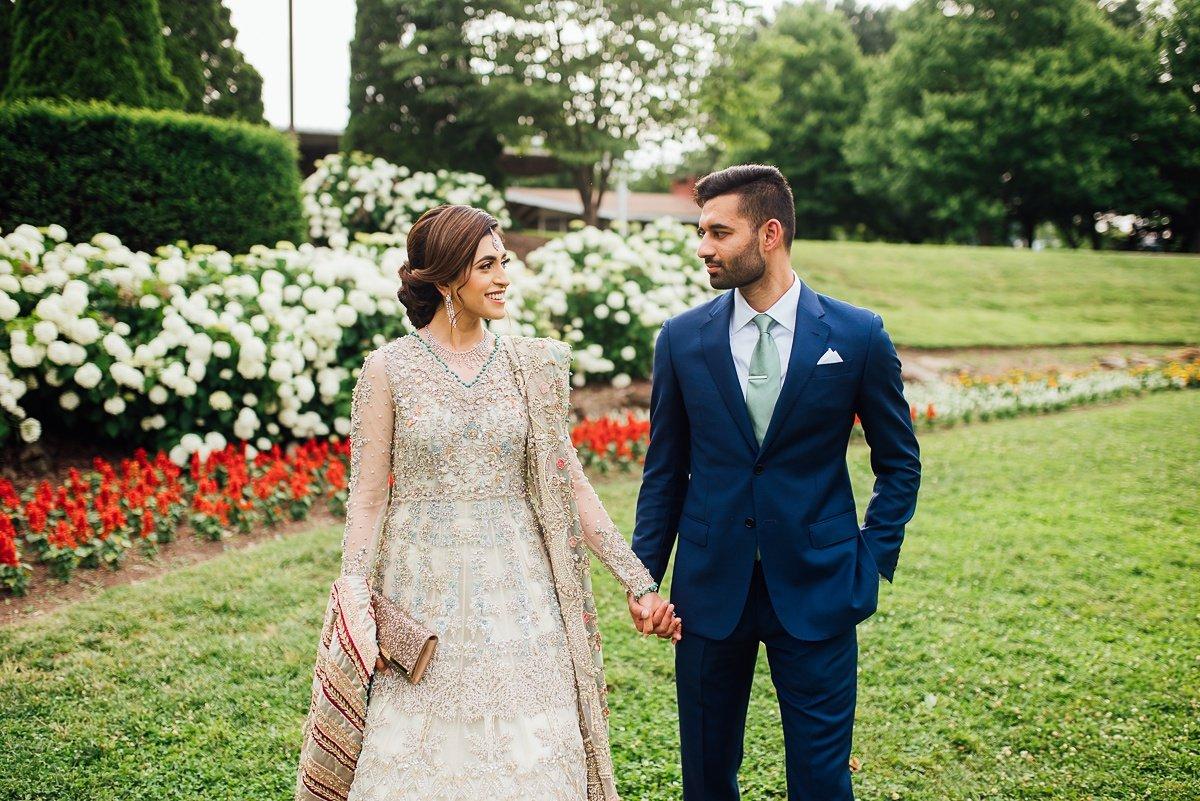 couple-holding-hands Osama + Sanah | Centennial Park and JW Marriott Wedding