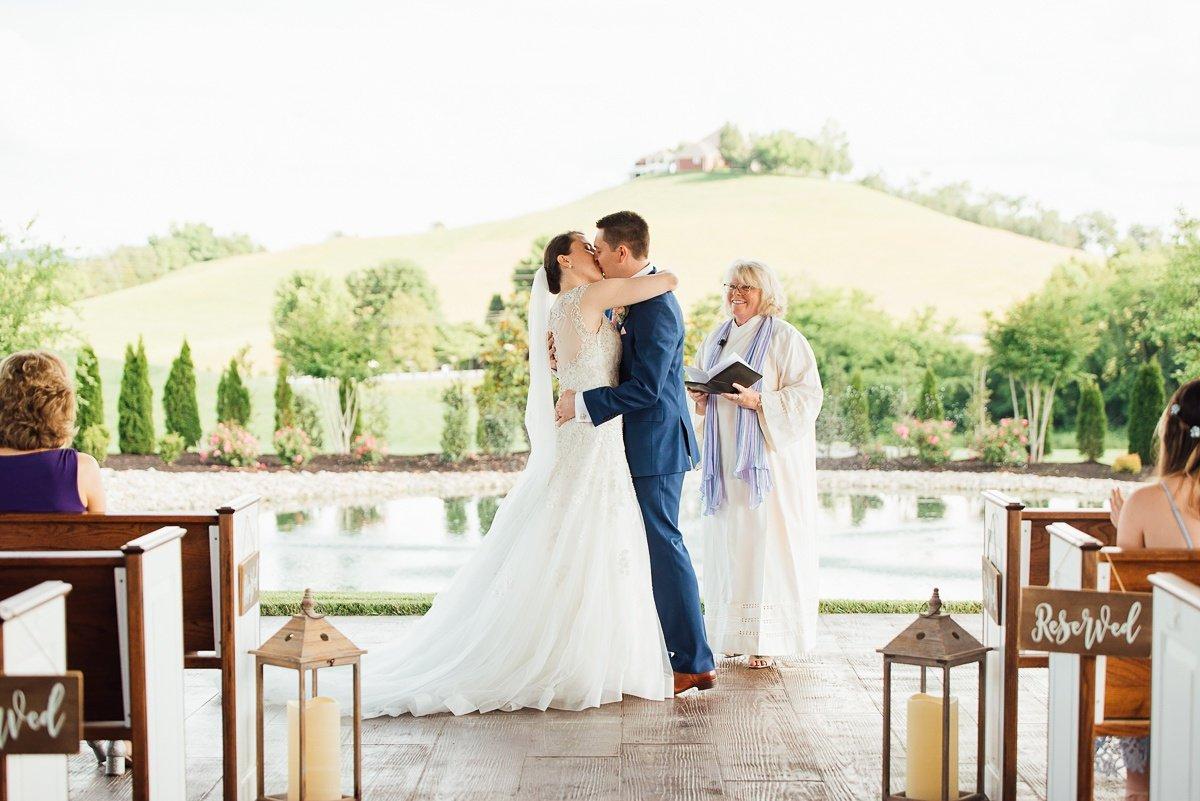 first-kiss Laura + Robert | White Dove Barn Wedding