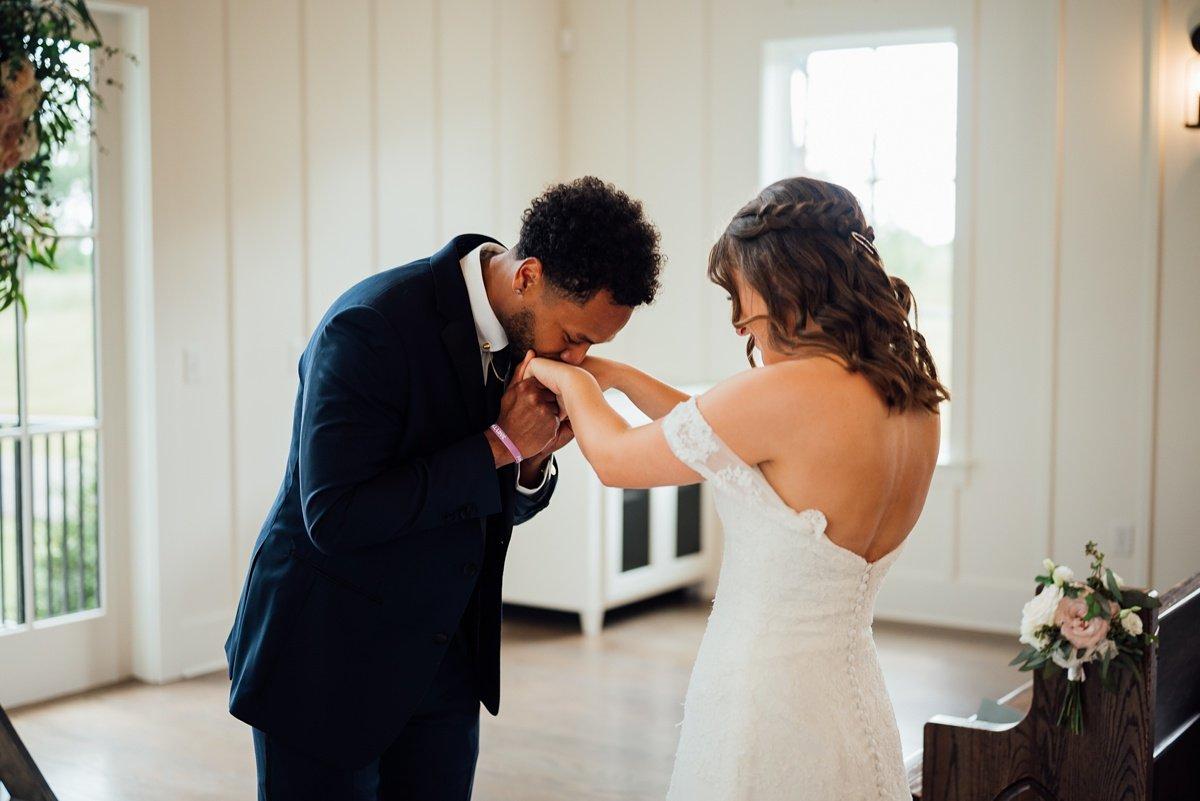 groom-kissing-hands Jessica + Jethro   The Venue at Birchwood   Spring Hill, TN
